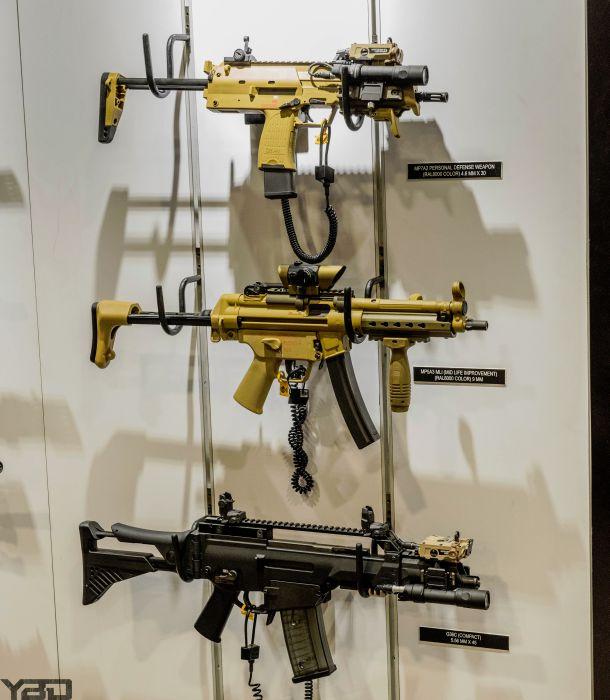 The HK MP7 (top), MP5 (middle), and G36C (bottom).